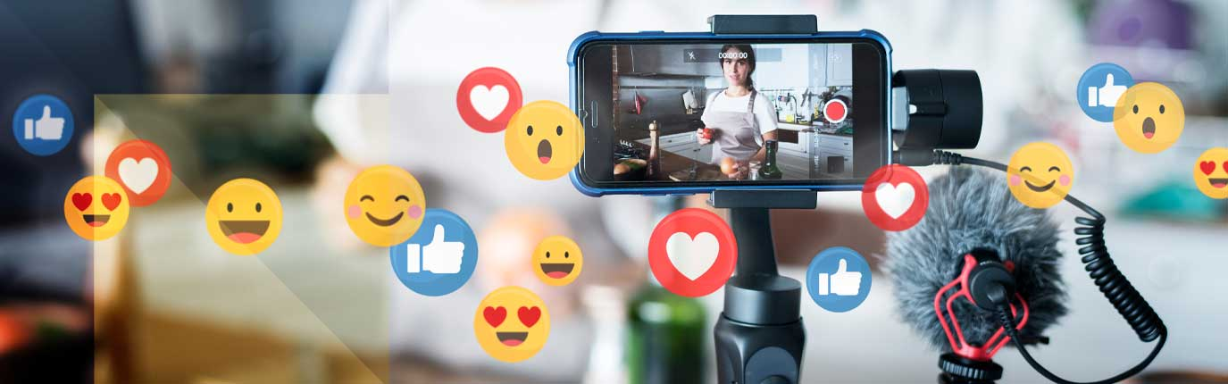 a mobile is recording video of vlogger with different emoji icons